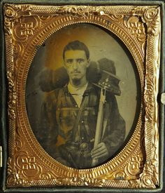 "ca. 1861, [ambrotype portrait of a Confederate soldier wearing a plaid shirt and a holstered pistol. He carries a large bedroll, a percussion rifle and a kepi with the letters ""4 SLG"" for the 4th Sumter Light Guards]"