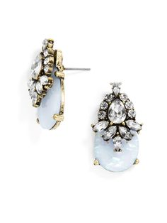 This soft statement drop features a sky blue opal cabochon with intricate crystal work.