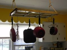 Old window turned pot rack. Repurpose windows.