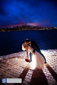 www.RickHelmanPhoto.com 914-315-9737 845-638-0221 201-818-1514  Bride and groom portrait, night time shot, NYC.  Waterside Caterers, North Bergen, NJ