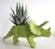 dino planter from repurposed plastic toy... love this idea but not a plant fan... maybe I'll paint & cut into a dino toy for B to make a little container for her hair clips or something?