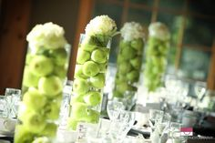 apple wedding centerpieces with green flowers Green Apple Wedding, Fruit Wedding, Fall Wedding, Wedding Flowers, Apple Wedding Centerpieces, Flower Centerpieces, Centerpiece Ideas, Apple Decorations, Reception Decorations