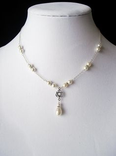 White Swarovski Pearl, Antique Sterling Silver Filigree, Teardrop Pendant Necklace, Sterling Silver Chain, Wire Wrapped, Y Necklace, Bridal. $59.00, via Etsy.