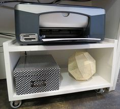 Simple under-desk rollie cart for printer. Great idea.