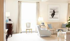 """Drew Doggett's """"The Chase"""" brings graphic impact to this neutral living room."""