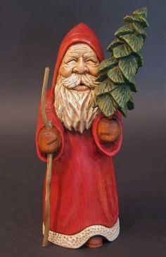 Lovely Hand carved Santa with Tree.  Photo via web