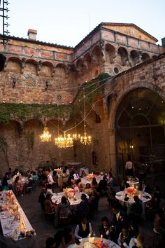 """Al Fresco Dining with hanging chandelier lighting   Destination DIY vintage wedding in Italy   Martina Liana Dress   Styling by WedInItaly   Pink and gold colour scheme   outdoor reception   Images by Anushé Low   <a href=""""http://www.rockmywedding.co.uk/lavinia-sav"""" rel=""""nofollow"""" target=""""_blank"""">www.rockmywedding...</a>"""