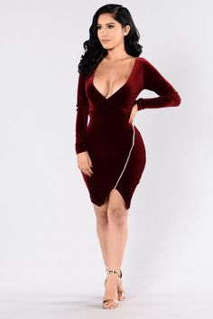 - Available in Burgundy and Gold - Velvet Dress - Long Sleeve - Surplice V Neckline - Ruched Overlap Bottom w/ Zipper Detail - Knee Length - 100% Polyester