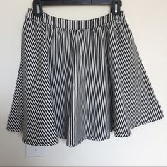 Forever 21 circle skirt  Striped black and white shirt. Short. Adjustable with zipper. Runs true to size. 16 ins waist to hem. I love this skirt. Used to always pair with denim shirt. Sadly does not fit me anymore :( Forever 21 Skirts Circle & Skater