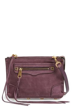 Swooning over this Rebecca Minkoff crossbody in aubergine with gold hardware for a fun splash of color for fall. The subtle whipstiched detailing contributes to the boho-chic style.