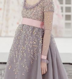 pink sash on a dress that's pure confetti!