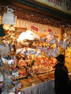 A doll and toy stand at the Munich Christmas market at Marienplatz. Prominently featured are stuffed representations of Aloisious, the Hofbrauhaus Angel.