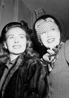 Jeanne Crain and Ginger Rogers looking out of their train car on the way to Miami, Florida (ca. 1951)