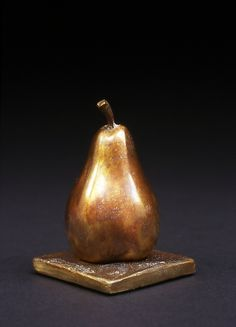 This sculpture is from the artist's French Lessons series, with titles in French and English. Each sculpture had its own individual actual forelle pear model. The patina is a rich bronze tone on a solid bronze sculpture. Moon Pear - Poire de Lune I by Darlis Lamb: Bronze Sculpture available at www.artfulhome.com