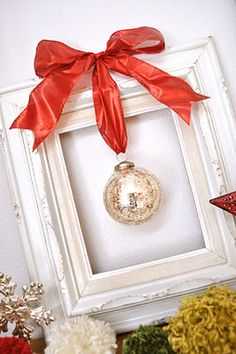 """Framed Christmas Ornament on the mantle-- great for those special ones that get """"lost"""" on the tree."""