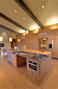 Contemporary Kitchen with One-wall, Undermount sink, Kitchen island, HI-MACS Solid Surface Sample in Steel Grey, Flush