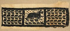 Fragment of a Band with a Hare century Geography:Made in Egypt Culture:Byzantine Medium:Linen, wool Dimensions:Overall: 7 x 16 x Framed: 11 x 22 x 1 in. x x cm) Classification:Textiles-Woven Textiles, Textile Patterns, Medieval Tapestry, Medieval Art, Medieval Embroidery, Egypt Culture, Tapestry Weaving, Byzantine, Metropolitan Museum