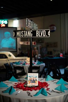 Street Sign Centerpieces | Retro Wedding In West Palm Beach Florida At Ragtops Motorcars | Photograph by Minerva Photography  http://storyboardwedding.com/retro-wedding-west-palm-beach-florida-ragtops-motorcars/