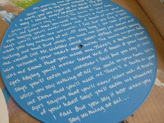 Writing song lyrics on a record. I'd do this using a silver sharpie, without painting over the black.