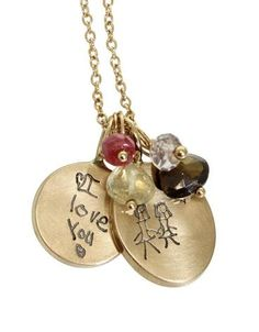 One highly distinctive aspect of our collection is our custom stamps made from your personal handwriting, company logo or even kids' drawings.  This sweet cluster cherishes your little one's creativity and can be worn and passed down for generations.  These 14k yellow gold round and oval charms are timeless.  Pair these with your little one's birthstones.
