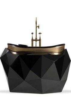 The Diamond Bathtub turns heads wherever it stands. It features a wooden structure finished in a high gloss black varnish, a colour that contrasts perfectly with the gold-painted rim, covered in high gloss varnish. Besides its irregular shape inspired on its jewel's name, it has a built-in oval tub that will provide you with the most comfortable soak.  #bathroomdesign #contemporarybathrooms #modernbathrooms #classicbathrooms #mid-centurybathrooms #eclecticbathrooms #luxurybathrooms