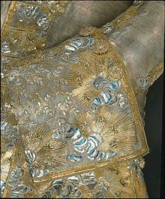 Detail cuff, 3-piece court suit, wedding suit of Gustav III. of Sweden, Sweden, 1766. Silver silk lamé, embroidered with blue foil, gold threads and sequins. The design consists of clouds and blazing suns with flower seedlings.