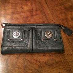 Marc by Marc Jacobs wallet Excellent condition! Marc by Marc Jacobs black leather wallet with silver hardware. Bought at Nordstrom. No tags. Only used a handful of times! Minimal damage to hardware. A few age spots on inside of wallet but awesome condition!  AUTHENTIC!!!                                     NO TRADES .                                         Make an offer! Marc by Marc Jacobs Bags Wallets