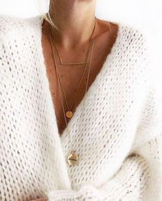 6665873a565 Learn more on how to wear layered necklaces - Chunky white sweater and a  layered necklace. Irina Zhovk
