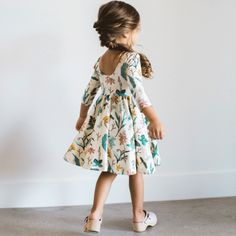 Soft and twirly play dress with a low scoop back, cropped long sleeve, and circle skirt. Restocking currently, coming soon. 95% cotton 5% lycra made in usa **