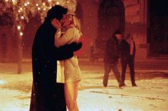 bridget jones and mark darcy, and when he wraps his coat around her, le sigh!