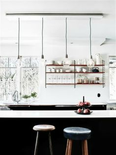 It looks like there's a winter wonderland outside these windows, but the dark cabinets inside keep the bright space grounded in warmth. The sparse, nordic feel is done in such a way that it feels clean and welcoming, instead of bare and cold. So calming. #ThisOldHouse kitchen inspiration via www.L-2-Design.com