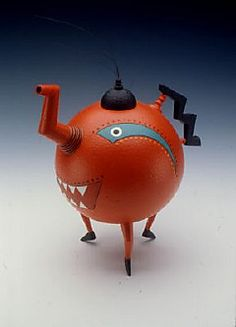 """The Artful Teapot Dixon Memphis Exhibition ran May 11 thru Sept. 24, 2006. Illustrated is """"Orange Pekoe"""" by Michael Hosaluk. On display were 250 teapots from the more than 6,000 amassed by collectors Gloria and Sonny Kamm."""