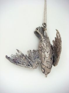 Sterling silver cast dead bird necklaces from Mielle Harvey.
