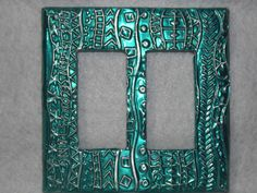 """Double Light Switch Cover """"Alpha"""" Hand Made $12.99 + Shipping. All of our items use quality materials. Switchplates are handcrafted to create a beautiful piece of art for your home. A piece of 40 gauge metal sheeting is hand embossed with a gorgeous design and then wrapped around an unbreakable nylon plate. Some designs are also hand painted to enhance the beauty. Finally the plates are coated with a water proof finish for added protection. They can be wiped clean with a damp cloth if…"""