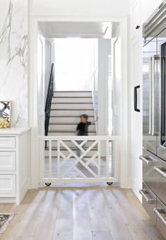 So in love with this built-in rolling baby and pet gate! Design by Lori Paranjap… So in love with this built-in rolling baby and pet gate! Design by Lori Paranjape Baby Gate For Stairs, Diy Baby Gate, Stair Gate, Wood Baby Gate, Pet Gate, Diy Dog Gate, Home Gadgets, Pocket Doors, Spring Home