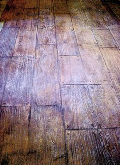Stamped and stained concrete floors made to look like wood floors. AWESOME!