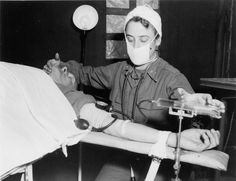Nurse administer anaesthesia to patient in the 8th Evacuation Hospital from University of Virginia Visual History Collection ·  ·  · Albert and Shirley Small Special Collections Library, University of Virginia.