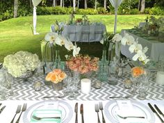 Peach garden roses and stock, white phalaenopsis orchids and hydrangeas, dusty miller.