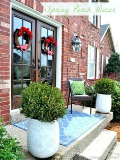 Front Porch Décor - two large white planters...topiary?