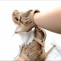 Fringe Nude Heels These are a bloggers favorite heels with fringe. You got to have this like now! Faux leather fringe adds playful movement to these statuesque heels styled with modern buckle straps. These are new but have no box.   4.5'' heel Back zip closure Man-made Lilianna Liliana Shoes Heels