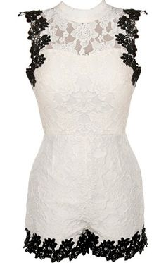 Soho Beach Romper: Features an elegant high-neck with a sheer lace yoke and sexy open-back, bold black crochet trim highlighting all edges, fully lined body for no show-through, and adorable romper shorts to finish.