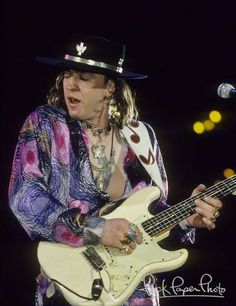 Stevie Ray Vaughan.......... This is the look he'd get lost in playing the Blues from his soul. Gone too soon.