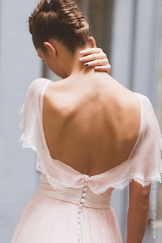 Backless romantic long dress for wedding guest. Maybe a cool bride can wear it too. It's so beautiful. The updo is weird but it's fine.