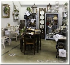 Love the white plates hanging from a vintage door/shutter and the wreath within a picture frame.