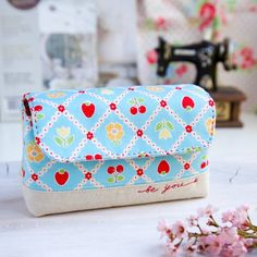 Learn how to make this cute and handy pouch. Step by step photo tutorial shows you how. Lot's of sewing inspration here.