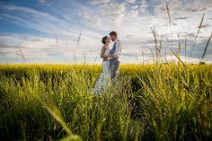 Wedding photos in the canola fields of Alberta, Canada. Olds, Alberta. Vintage, rustic barn wedding #wedding #canolafield #alberta #prairies