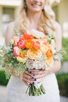Beautiful coral and peach bouquet with Garden Roses, Ranunculus, and Poppies. #wedding #flowers