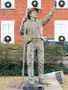 """The Discovery"" bronze statue of a gold miner to commemorate the discovery of gold in White County Georgia in the 1800s. Statue was placed next to the old White County Courthouse on the square in Cleveland Georgia in July 2013. Artist is Gregory Johnson. Photo taken Dec 2014."