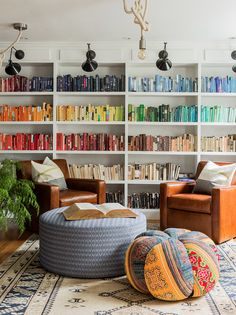 Perfectly color-coded bookshelf in an eclectic family room by Hudson Interior Design