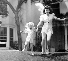 Christina and Joan Crawford make the most of a sunny day in Brentwood, CA (1943)